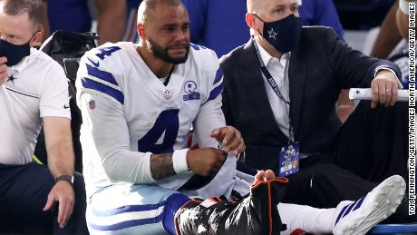 Dak Prescott was carted off the field in tears after suffering a serious ankle injury.
