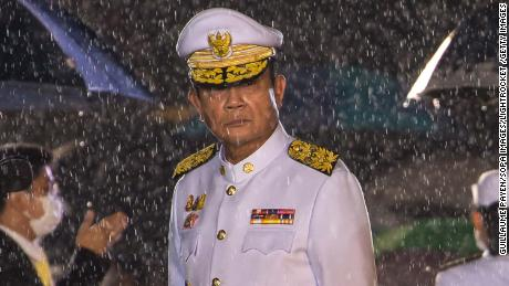Prime Minister Prayut Chan-o-cha is seen amidst a heavy downpour during an event marking the death of late Thai King Bhumibol Adulyadej on October 13.