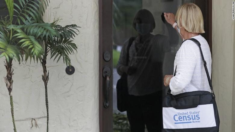 A census taker knocks on the door of a residence Tuesday, Aug. 11, 2020, in Winter Park, Fla.
