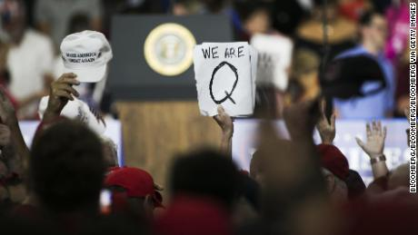 An attendee at a Trump rally holds up a QAnon sign on August 4, 2018. (Bloomberg via Getty Images)
