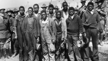 Clarence Norris, Olen Montgomery, Andy Wright, Willie Roberson, Ozie Powell, Eugene Williams, Charlie Weems, Roy Wright, and Haywood Patterson were arrested in 1931 in Alabama.