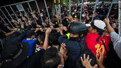 Pro-democracy protesters seen pushing back Thai police during an anti-government demonstration on October 14, 2020 in Bangkok, Thailand.