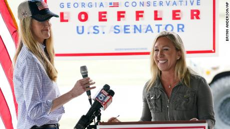 Republican congressional candidate Marjorie Taylor Greene, right, introduces Sen. Kelly Loeffler, during a news conference on Thursday in Dallas, Georgia.