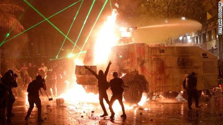 Chile protest anniversary turns violent as churches burned, police fire tear gas