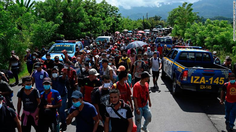 TOPSHOT - Honduran migrants, part of a caravan heading to the US, walk in Entre Rios, Guatemala, after crossing the border from Honduras, on October 1, 2020. - A new caravan, of at least 5,000 people, left San Pedro Sula on Wednesday midnight in search of the American dream amid the new coronavirus pandemic, which has left over 2,300 dead in Honduras so far.