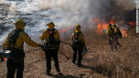Firefighters set a backfire to protect homes and try to contain the Blue Ridge Fire.