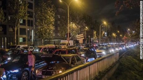 People travelled in and out of the French capital on Thursday before the new restrictions were imposed.