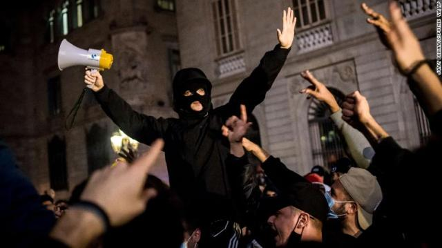 """At least 12 people were detained in the northeastern region of Catalonia after """"riots"""" erupted."""