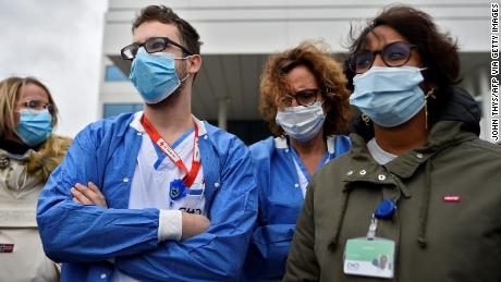 Employees at the MontLegia hospital, in Liege, Belgium, as wards face a surge in admissions.