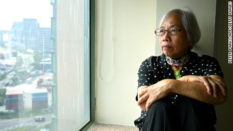 Pro-democracy protester Alexandra Wong, nicknamed Grandma Wong, who disappeared midway through the city's democracy protests in 2019 and resurfaced in Hong Kong two days ago after 14 months away, posing for a photo in her hotel room in Hong Kong.