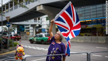 Activist Alexandra Wong waves a British Union Jack flag during a gathering outside the government headquarters to mark the fourth anniversary of mass pro-democracy rallies, known as the Umbrella Movement, in Hong Kong on September 28, 2018.