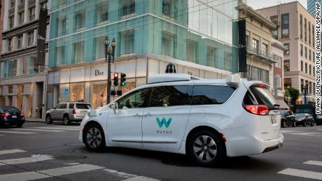A Waymo self-driving car drives in San Francisco in 2018.
