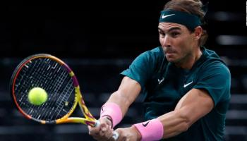 Nadal returns a backhand to compatriot Lopez.