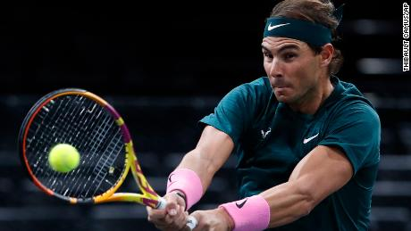 Nadal returns a backhand to compatriot Lopez.