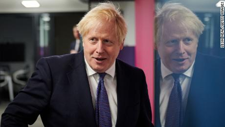 UK Prime Minister Boris Johnson visits the headquarters of Octopus Energy on October 5 in London