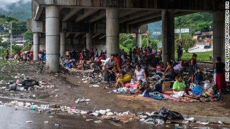People who were forced to abandon their homes in the San Pedro Sula Valley due to floods in the aftermath of Hurricane Eta take refuge in a makeshift camp underneath an overpass in Chemelecon, Honduras.