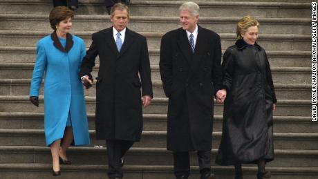 President George W. Bush, first lady Laura Bush and former President Bill Clinton and first lady Hillary Rodham Clinton exit the Capitol building following the presidential inauguration ceremony January 20, 2001.