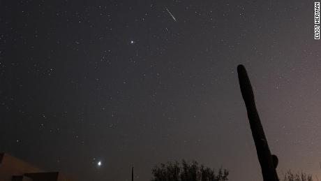A leonid meteor shoots across the sky in Tucson, Arizona, with Jupiter and Venus visible as well.