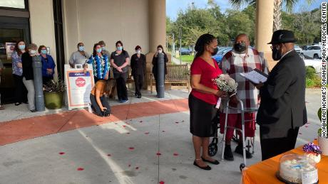 Health care workers at Orange Park Medical Center observe Brown's and Bell's wedding.