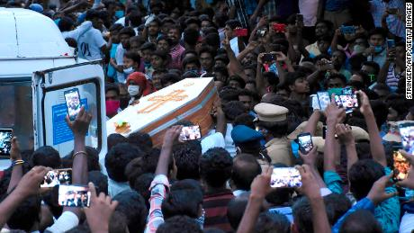 Residents gather as they carry the coffin of Jayaraj and son Bennicks, who were allegedly tortured at the hands of police in Sathankulam.