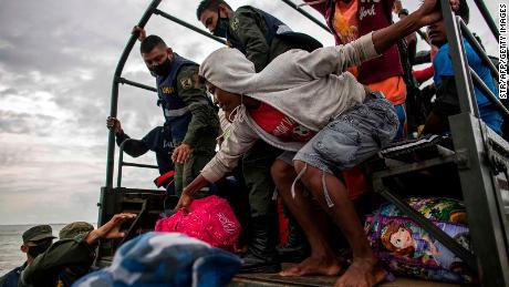 Members of the Navy help evacuate people from the communities of Karata and Wawa Bar before Hurricane Iota hits Bilwi, Puerto Cabezas, Nicaragua on Sunday.