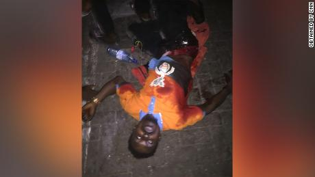 One of the protesters, Mathew, pictured, says he was injured when the army opened fire at Lekki toll gate. Using metadata, CNN geolocated the image to the protest location at 6:50 pm.