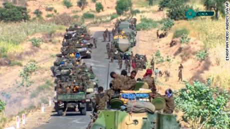 This image, made from undated handout video released by the state-owned Ethiopian News Agency on November 16, 2020, shows Ethiopian military gathered on a road in an area near the border of the Tigray and Amhara regions of Ethiopia.