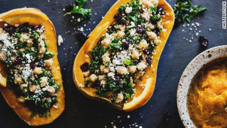 Stuffed squashes with quinoa, kale, cranberries, and chickpeas are a colorful addition to the holiday table.