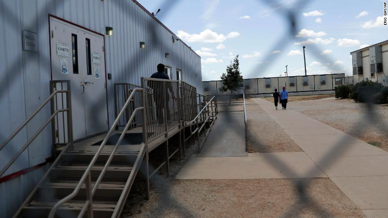 Detained immigrants walk outside the ICE South Texas Family Residential Center in August 2019. Two children detained at the facility are asking leaders to step in and stop their deportation.