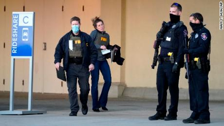 Police and FBI agents investigate a shooting at Mayfair Mall in Wauwatosa, Wisconsin, on Friday, November 20.