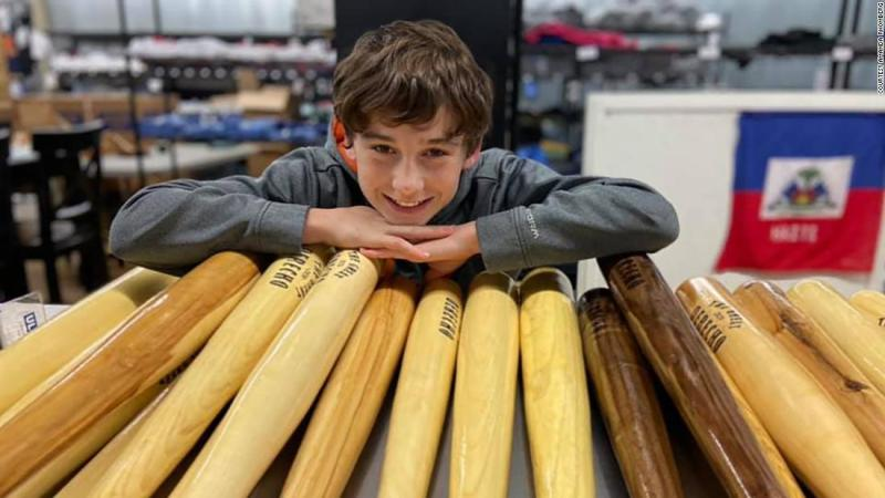 An Iowa boy is selling baseball bats he makes from fallen trees to raise money for storm victims