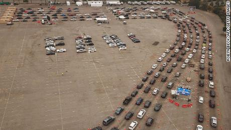 Drivers wait in lines at a Covid-19 testing site at Dodger Stadium in Los Angeles on Wednesday.