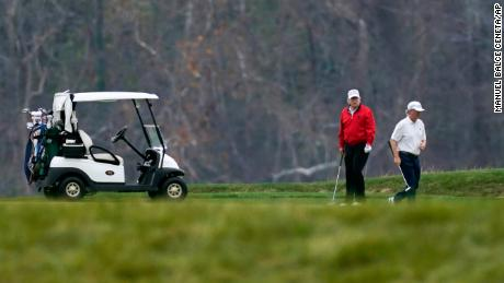 President Donald Trump plays golf in Sterling, Virginia on Saturday, November 21, 2020.