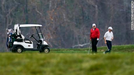 President Donald Trump plays golf at Trump National Golf Club in Sterling, Virginia, Saturday, November 21, 2020.
