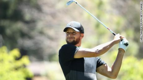 Curry plays a tee shot on the ninth hole during round two of the American Century Championship.