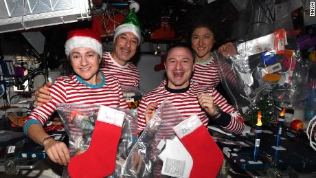 (From left) Mir, Permetano, Morgan and Koch celebrate Christmas in space - in Milan pajamas.