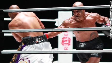 Mike Tyson throws a punch in the fourth round against Roy Jones Jr.