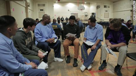 Sy Green, center, and Jason Bryant, right, participate in the reading group.