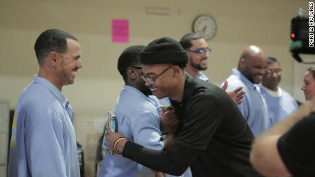 Sy Green embraces prisoners he met while participating in the reading group.