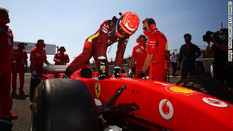 Mick Schumacher steps into his father's Ferrari F2004 before the F1 Grand Prix of Tuscany in September.