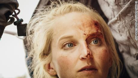 The climber suffered a deep cut to her head after a dramatic fall.