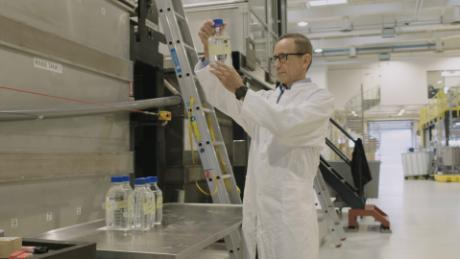 Joerg Hess, COO of Aquaporin A / S, controls the filtered water using the aquaporin membrane.