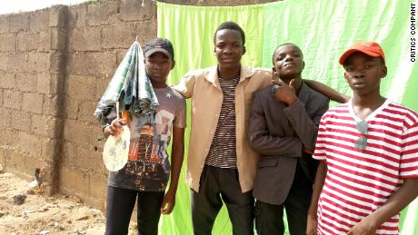 """Members of The Critics posing on the set of one of their short films, """"Chase,"""" in Kaduna, Nigeria."""