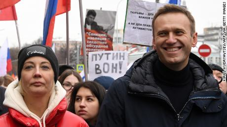 Alexey Navalny and his wife, Yulia, march in memory of slain Kremlin critic Boris Nemtsov in Moscow in 2019. Yulia became ill during a vacation in Kaliningrad.