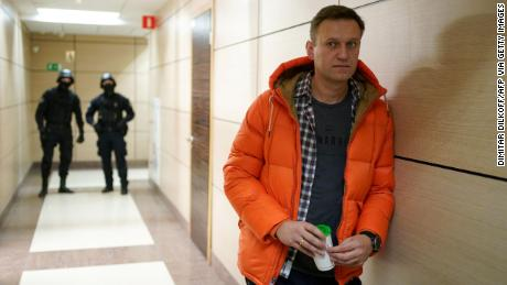 Russian opposition leader Alexey Navalny, photographed near law enforcement officers at his Anti-Corruption Foundation in Moscow last year, is always under surveillance.