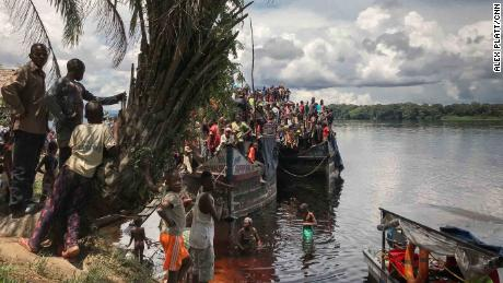 A passenger boat stops for a break on the shores of Ingende. These boats can take weeks to make their way down-river to Kinshasa.