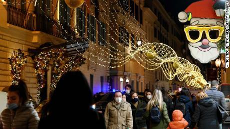 Italians do their Christmas shopping  near Rome's Piazza di Spagna on December 13.