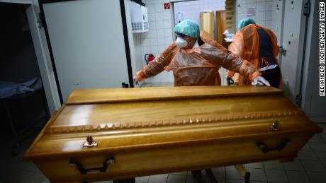 Funeral home workers move the coffins of Covid-19 victims to Annaberg-Buchholz, Saxony state on December 7, as the country experiences another spike in infections and deaths.