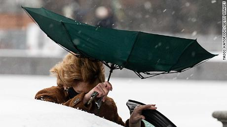 Sen. Debbie Stabenow (D-Mich) struggles with her umbrella in the snow Wednesday at the U.S. Capitol in Washington, DC.
