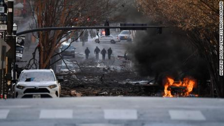 A vehicle is on fire after an explosion in Nasvhille on Friday, December 25, 2020.
